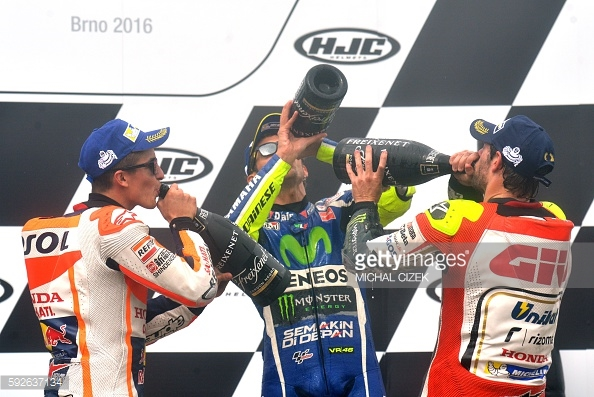Bottom's up... Crutchlow will definitely be wetting the baby's head tonight and celebrating his first ever MotoGP win - Getty Images