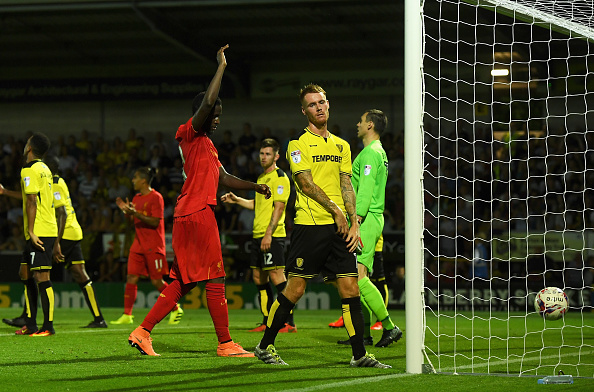 Above: Burton Albion defender Luke Naylor looking disheartened after turning the ball into his own net in their 5-0 defeat to Liverpool | Photo: Getty Images