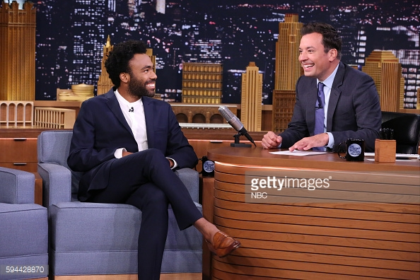 Glover sharing the love with Jimmy Fallon on The Tonight Show. Photo: Getty / NBC