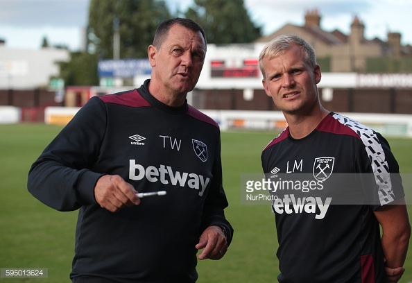 Above: West Ham academy coach Liam Manning with Terry Westley | Photo: Getty Images