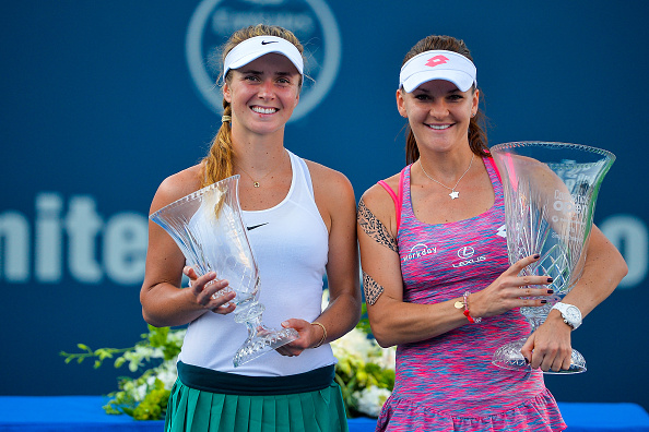 Radwanska and finalist Elina Svitolina (left) pose with their silverware after the conclusion of the final in New Haven last week. Photo credit: Alex Goodlett/Getty Images.