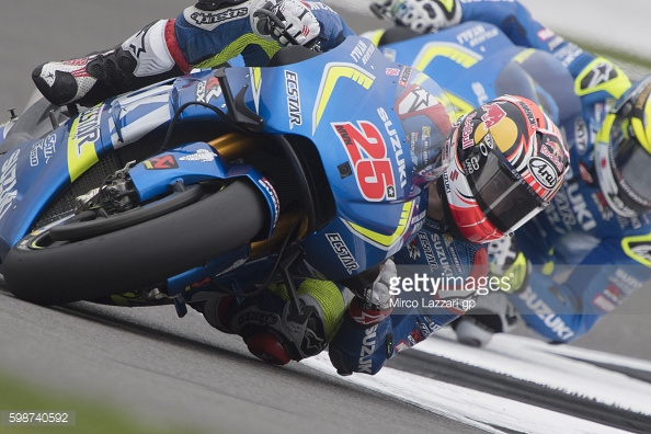 Team Suzuki Ecstar in action at Silverstone, Vinales leads Aleix Espargaro - Getty Images