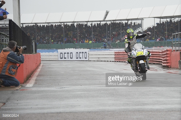 re-entering pits celebrating first MotoGP pole at his home round at Silverstone - Getty Images