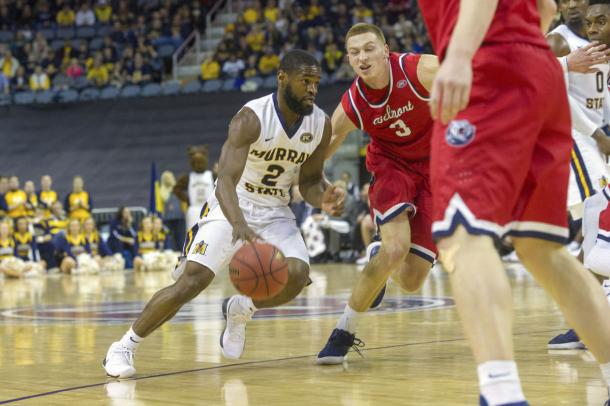 Murray State's Jonathan Stark drives past Belmont's Austin Luke in the Ohio Valley championship game/Photo: