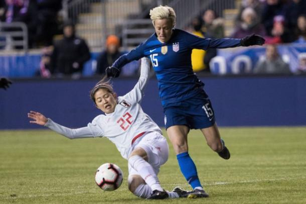 Megan Rapinoe tries to escape Risa Shimizu's tackle | Source: USA TODAY Sports