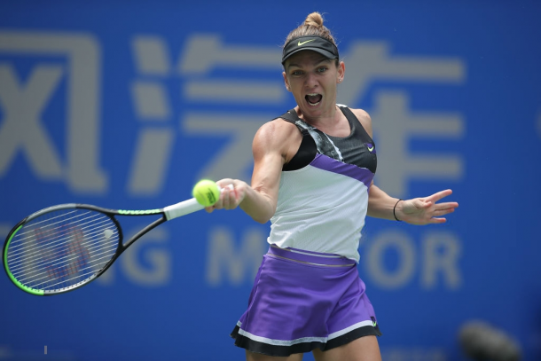 Simona Halep is struggling during the Asian Swing currently, dealing with a back injury in the process   Photo: Zhe Ji