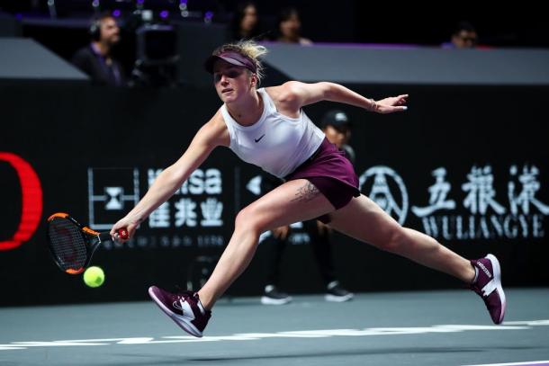 Elina Svitolina reaching for a ball | Photo: Clive Brunskill