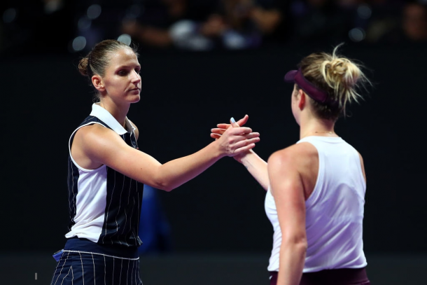 Pliskova and Svitolina meet at the net after the match | Photo: Clive Brunskill