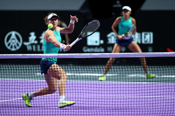 Stosur and Zhang in action | Photo: Clive Brunskill