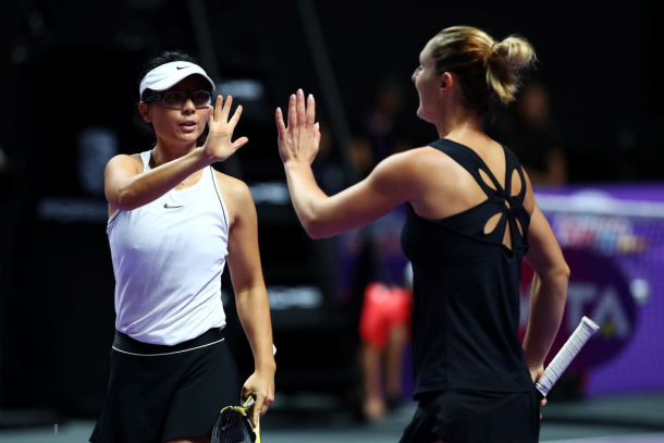 Dabrowski and Xu celebrating after winning a point | Photo: Clive Brunskill