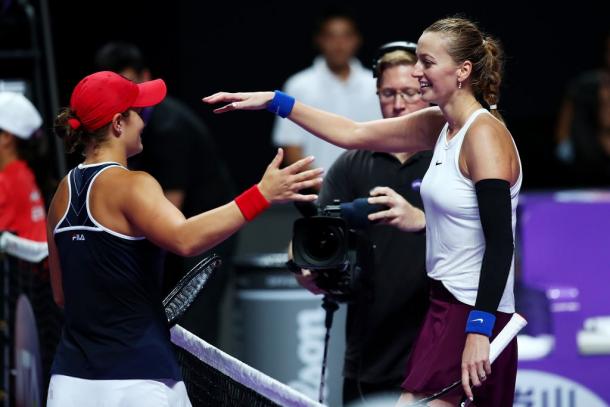 Kvitova and Barty share a nice hug at the net | Photo: Clive Brunskill