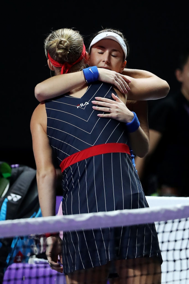 Both players share a hug after Bertens was forced to retire | Photo: Matthew Stockman