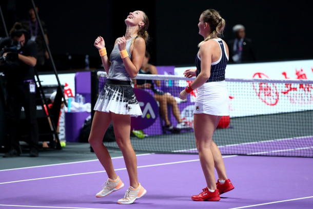 Babos and Mladenovic celebrate their win | Photo: Clive Brunskill