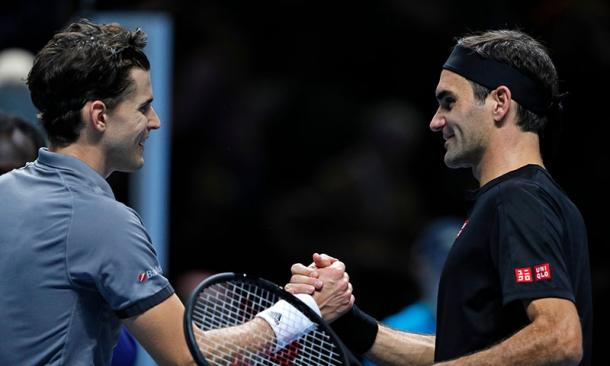 Thiem (l.) and Federer (r.) shake hands after the Austrian's victory/Photo: AFP