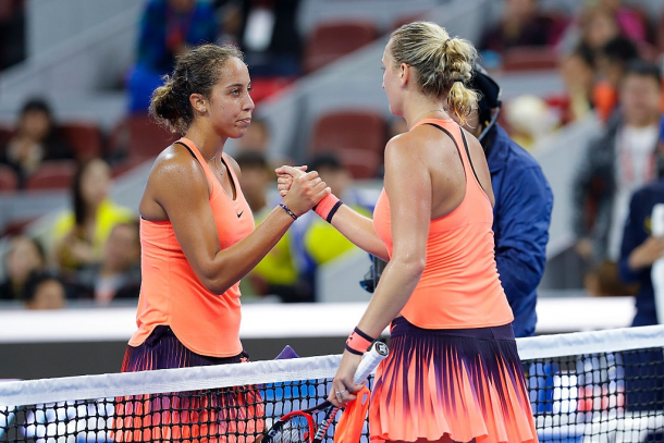 Keys (left) and Kvitova (right) embrace each other at that net after their quarterfinal clash in Beijing 2016, their most recent one. Photo: Lintao Zhang/Getty Images.