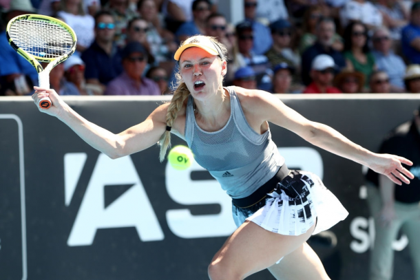 Caroline Wozniacki overcame a slow start and prevailed in the high-quality first set | Photo: Phil Walter