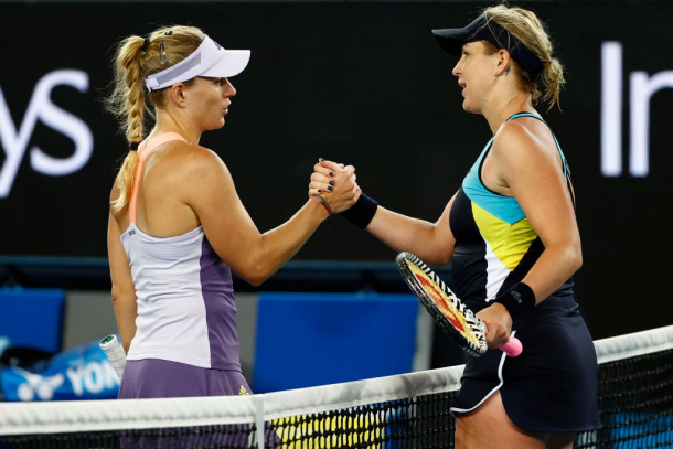 Pavlyuchenkova and Kerber meet at the net for a nice exchange after the net | Photo: Mike Owen