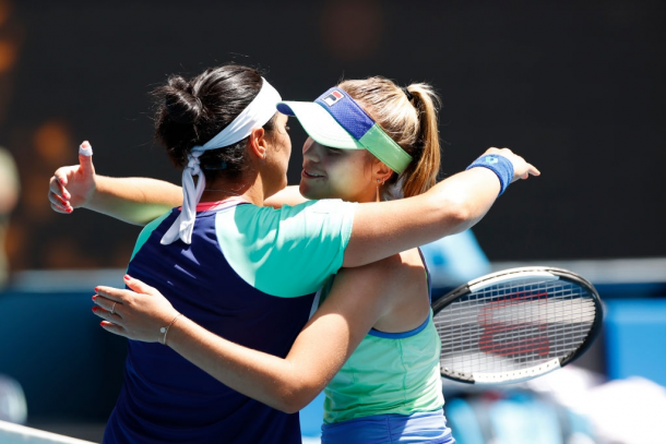 The two surprise quarterfinalists in Melbourne share a warm hug after the match | Photo: Fred Lee