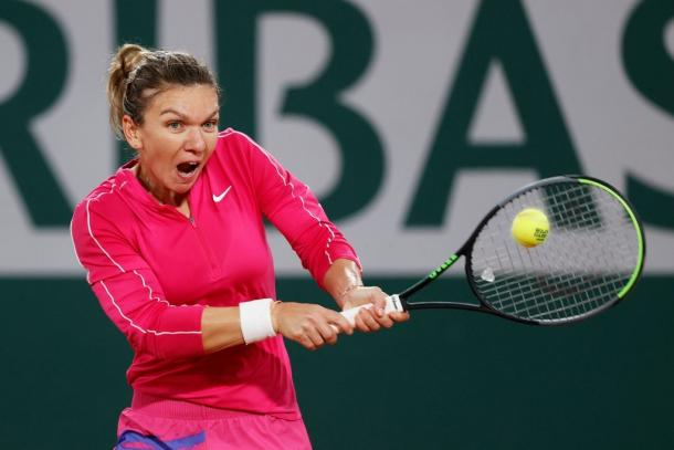 Halep hits a backhand in her destruction of her American opponent Friday. Photo: Clive Brunskill
