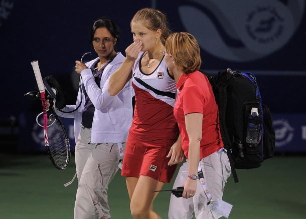 Chakvetadze being helped by tournament officials after collapsing on court at the Dubai Tennis Championships in 2011. Photo: