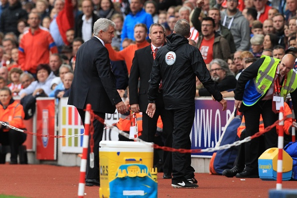 Part of a dismal day for Stoke saw Mark Hughes sent to the stands in the first half, where he watched his side fall to pieces. (Photo: Laurence Griffiths/Getty Images)