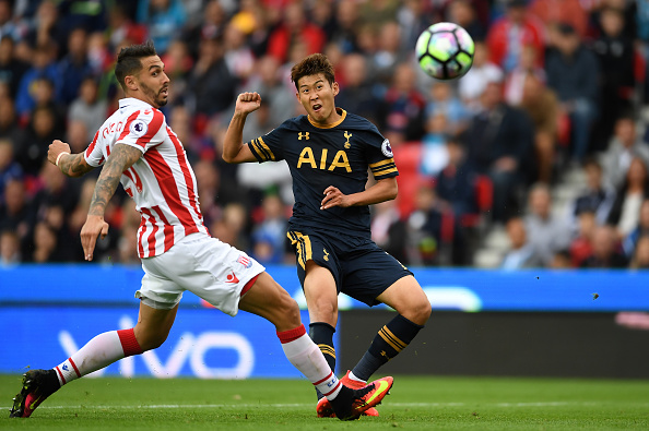 Heung-Min Son bends in Spurs' second. (Photo: Laurence Griffiths/Getty Images)