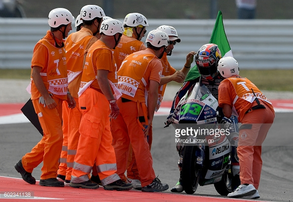 Bastianini being congratulated by the Marshals at his home circuit - Getty Images