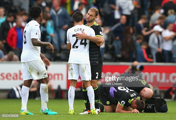 Above: John Terry laying injured during Chelsea's 2-2 draw with Swansea City | Photo: Getty Images