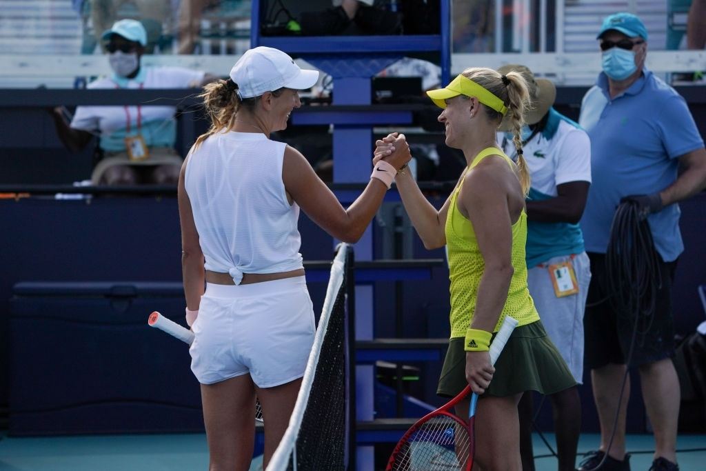 Azarenka and Kerber meet at the net after the conclusion of their third-round encounter which Azarenka won in straight sets. Photo: Icon Sportswire