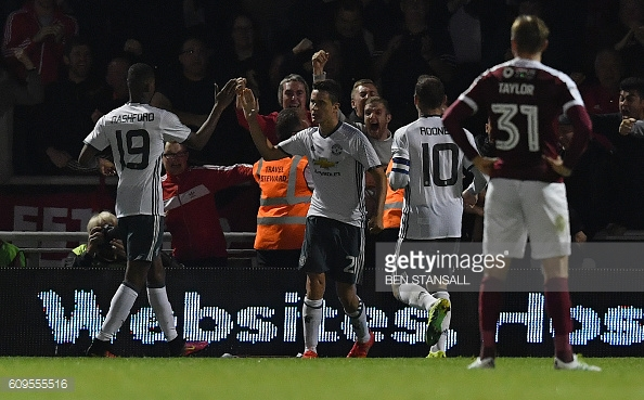 The Manchester United players celebrate Herrer
