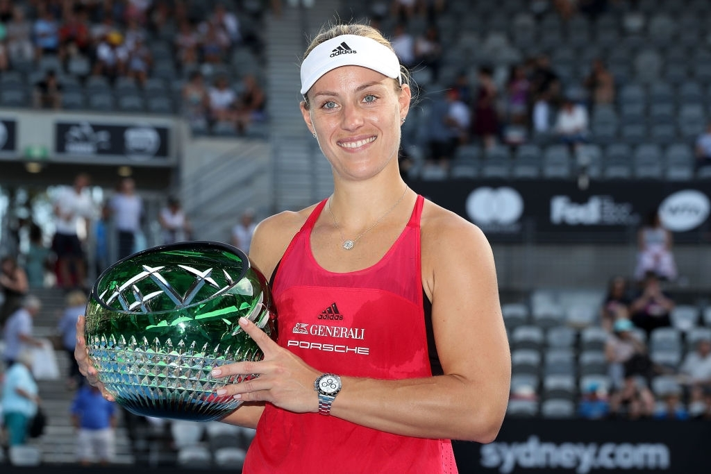 Kerber poses with her Sydney trophy after capturing the title here for the first time, in her second try. Photo: