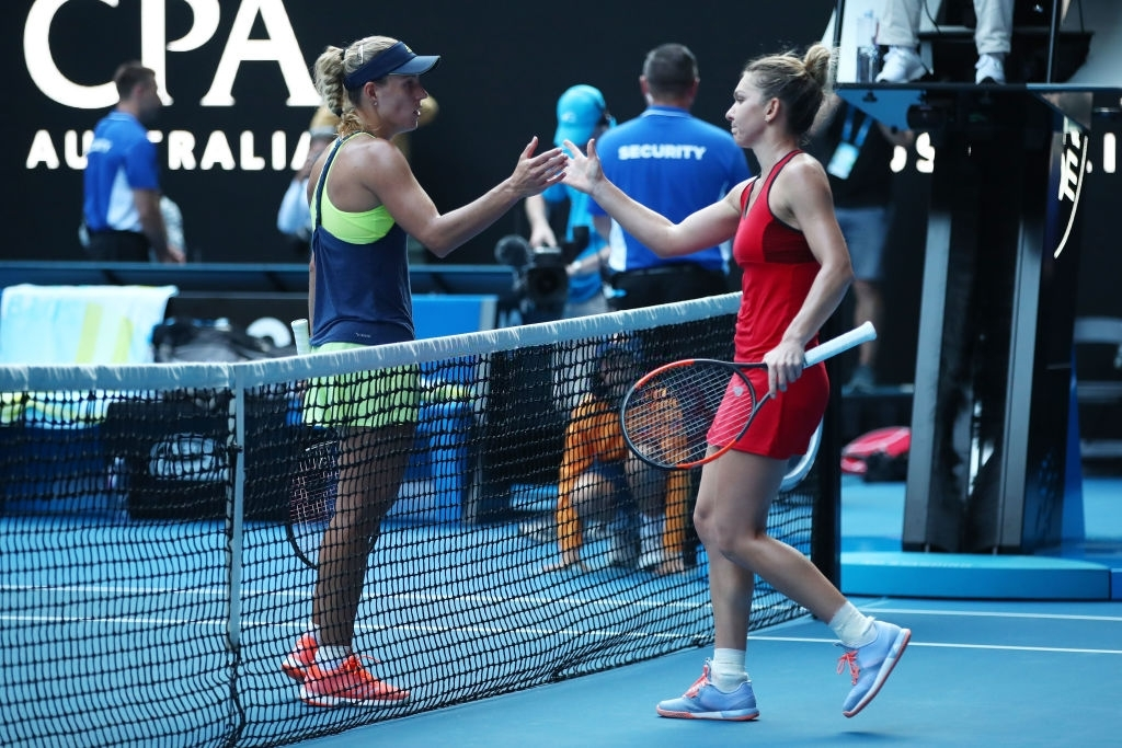 Kerber and Halep exchange handshakes at the net after their semifinal encounter at the 2018 Australian Open, which Halep won in a thrilling three-setter. Photo: