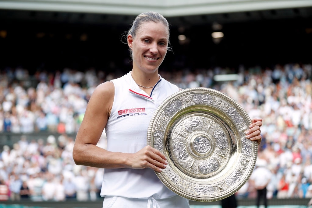 Kerber and the Venus Rosewater Dish after capturing the Wimbledon title in 2018 over Serena Williams, in a rematch of the championship round here two years ago. Photo: