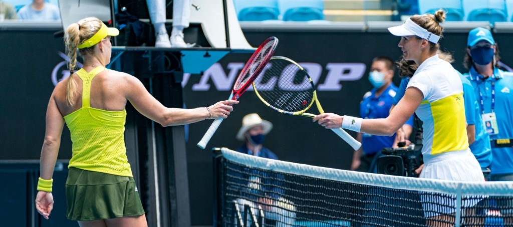 Kerber and Bernarda Pera (right) tap rackets after their opening-round meeting at the Australian Open this earlier this year. Photo: Andy Cheung