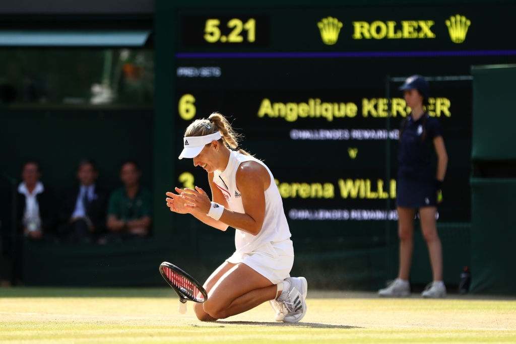 Kerber drops to the grass turf in celebration upon converting championship point in the 2018 Wimbledon final. Photo: Michael Steele