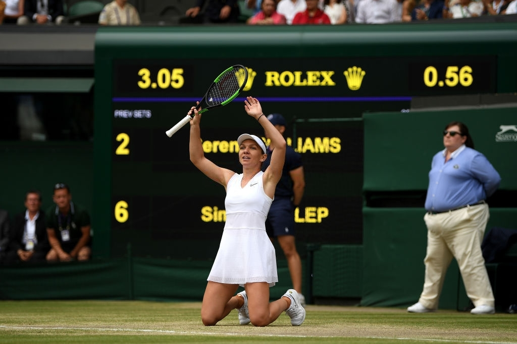Halep gestures in celebration after a successful championship point in the 2019 Wimbledon final. Photo: Shaun Botterill