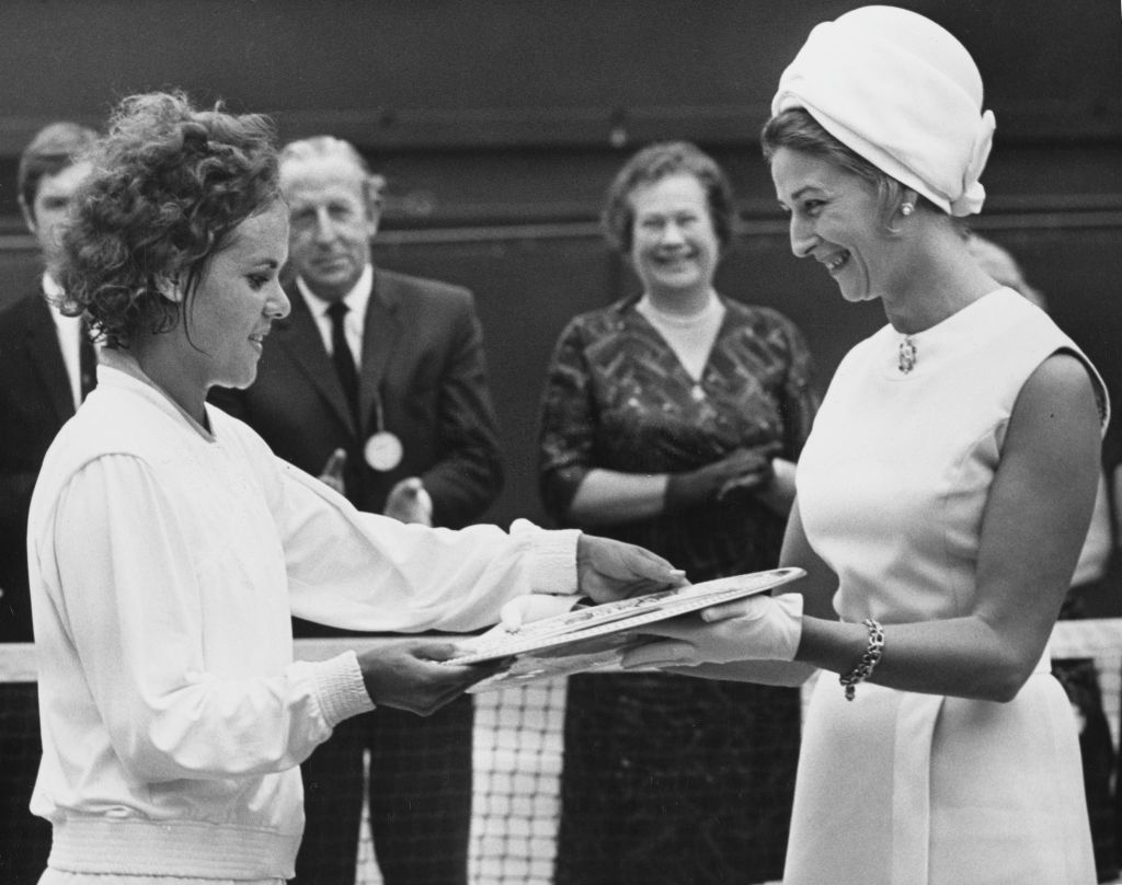 Goolagong accepts the Venus Rosewater Dish after winning Wimbledon in 1971, her first title here, a feat repeated in 2021, 50 years later, by fellow countrywoman Barty. Photo: Douglas Miller