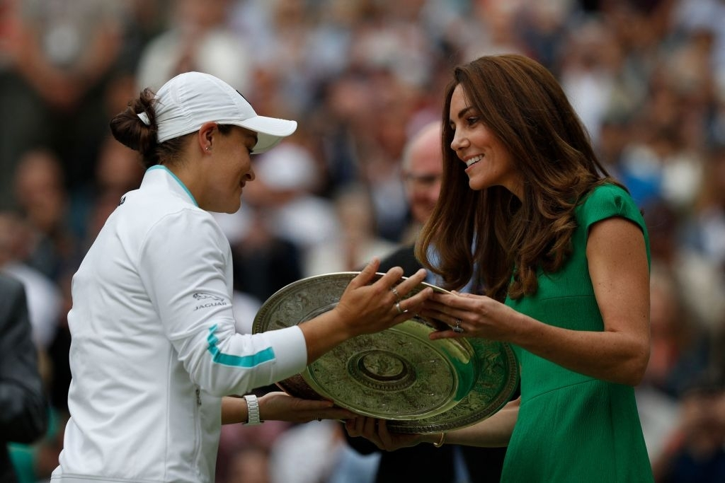 2021 Wimbledon champion receives her silverware from Catherine, Duchess of Cambridge, during the trophy presentation ceremony after the end of the finals' conclusion last weekend. Photo: Adrian Dennis