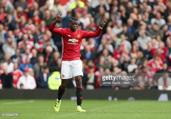 Pogba celebrating his first goal for United against Leicester | Photo: James Baylis - AMA / Getty Images