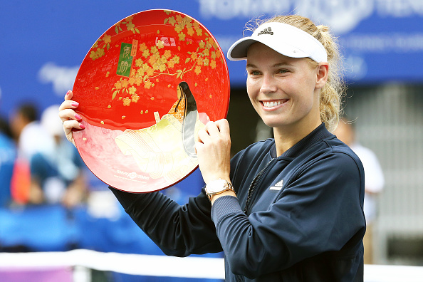 Caroline Wozniacki poses with the trophy after winning her 24th title at the Tokyo Open. Photo: Getty Images/Koji Watanabe