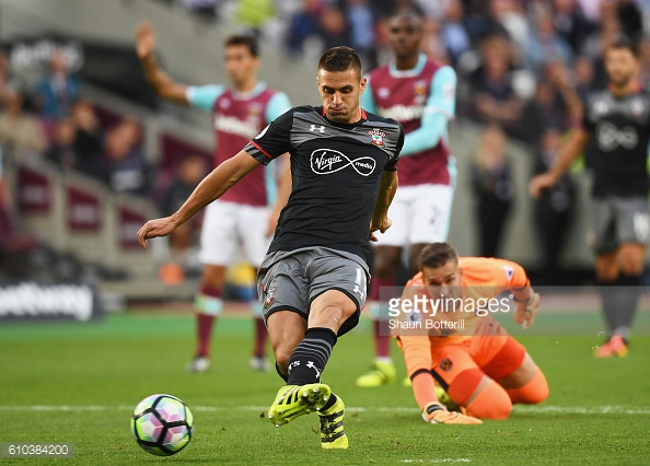 Above: Dusan Tadic firing home Southampton's second in their 3-0 win over West Ham | Photo: Getty Images