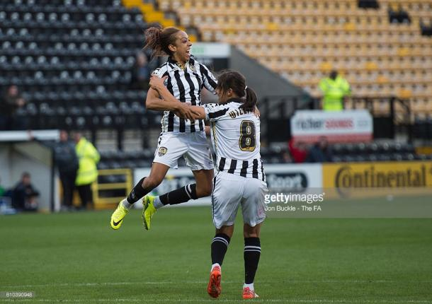 Clarke celebrates with Williams after nodding the Lady Pies ahead at home