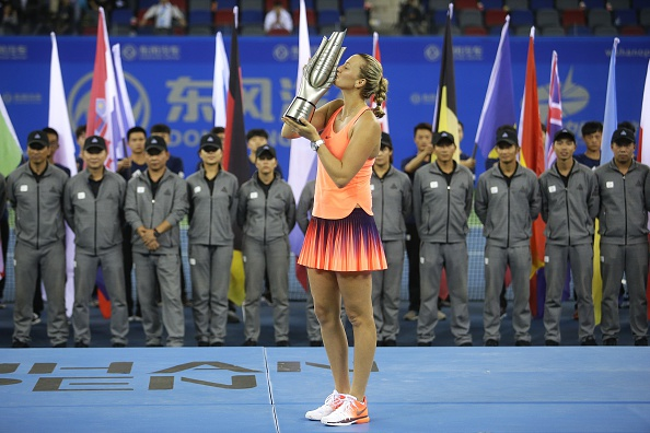 Kvitova lifts her first title of the year, her first in 13 months at the Dongfeng Motor Wuhan Open, also her second title at the tournament. Photo credit: Wang He/Getty Images.