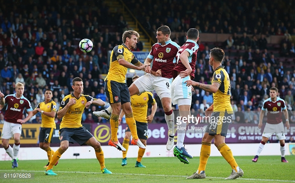 Sam Vokes rises to meet a corner. | Photo: Getty
