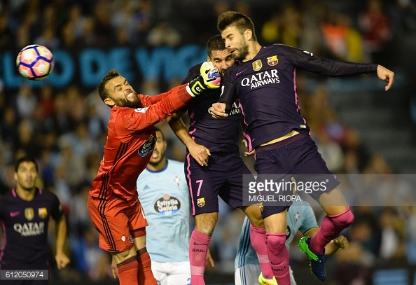 Above: Gerard Pique heading home one of his two goals in Barcelona's 4-3 defeat to Celta Vigo | Photo: Getty Images