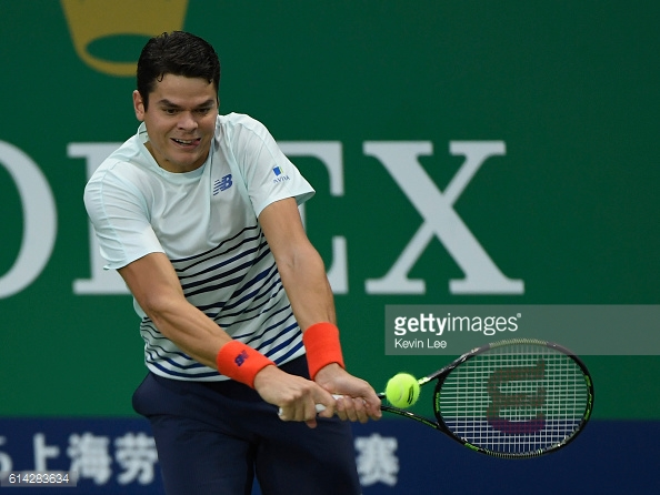 Milos Raonic hits a backhand during his third round loss to Jack Sock in Shanghai/Photo: Kevin Lee/Getty Images