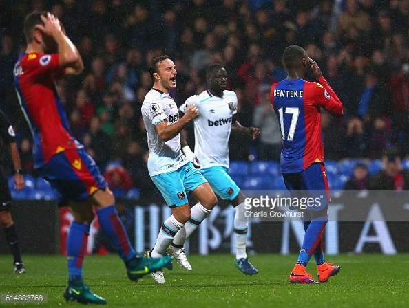 Above: Mark Noble celebrating Christian Benteke's penalty miss in West Ham's 1-0 win over Crystal Palace | Photo: Getty Images
