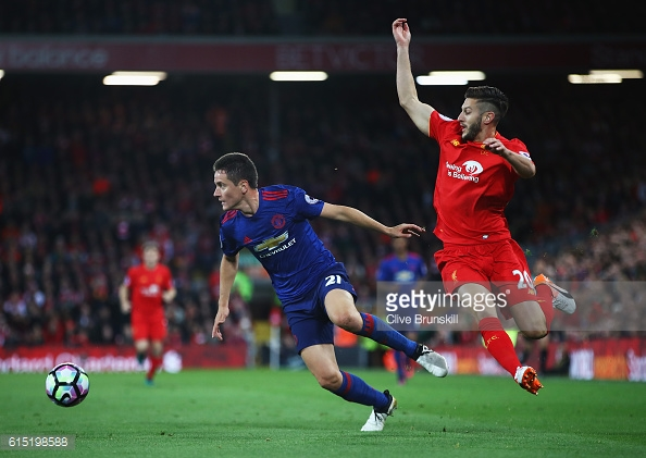 Above: Ander Herrera clashing with Adam Lallana in Manchester United's 0-0 draw with Liverpool | Photo; Getty Images