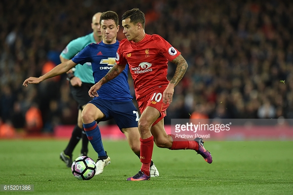 Ander Herrera battling for ball against Philippe Coutinho.