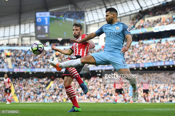 Sergio Aguero beats Sam McQueen to the ball in the first half | Photo: Getty images / Laurence Griffiths